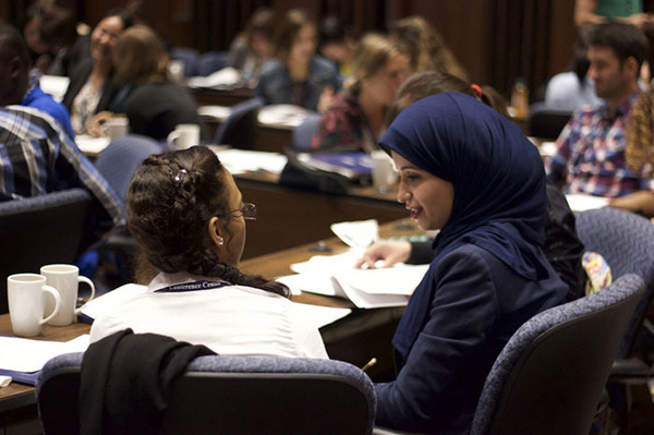 Two students talking together at an CSLC event