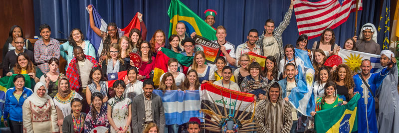 FLTA students holding flags of their countries